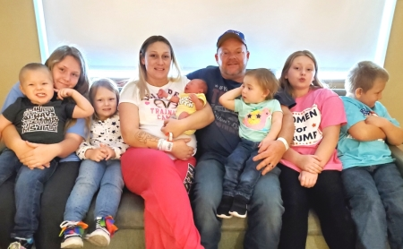 Morgan, Jerry III (in lap), Saydy, Sabrina holding Leap Day baby Elijah, Jerry Jr., Atara (in lap), Keira, Keagan.